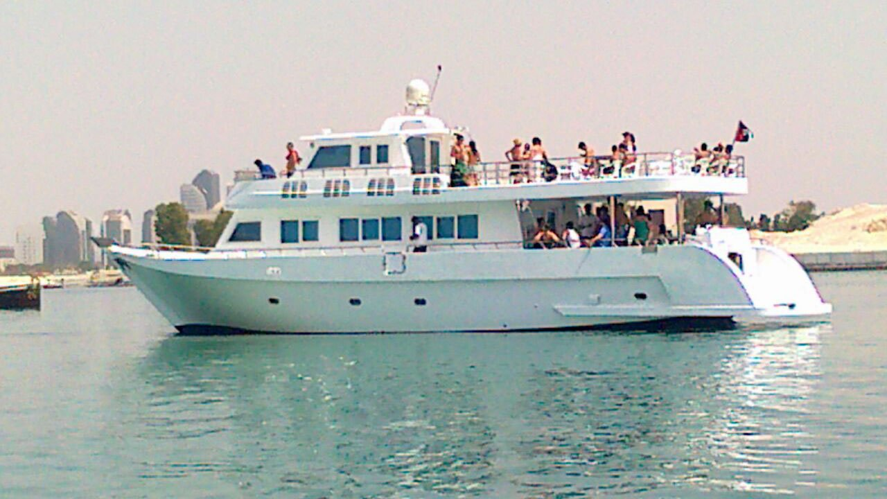Travelers on a yacht cruise in abu dhabi